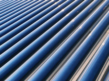 Heat pipe solar water heater. Heat pipes located on the roof to generate heated water from the sun Royalty Free Stock Photography