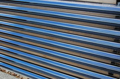 Heat pipe solar water heater. Heat pipes located on the roof to generate heated water from the sun Stock Image