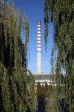 Heat and power plant. Among trees Stock Photography