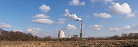 Heat power plant. On the horizon on a sunny day pano image Royalty Free Stock Photos