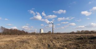 Heat power plant. Rising on the horizon on a sunny day pano image Royalty Free Stock Images