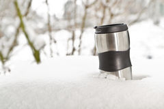Heat protection-thermos coffee cup on winter day Royalty Free Stock Photo