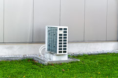 Heat Pump. Air heat pump from an industrial building. The outdoor unit heat pump, air to air stock photography