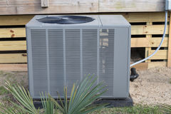 Heat Pump. Residential or commercial heat pump for heating and cooling buildings or homes royalty free stock images