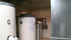 Heat pump and ventilation system in modern passive house boiler room stock video footage