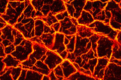 Heat red cracked ground texture. After eruption volcano Royalty Free Stock Images