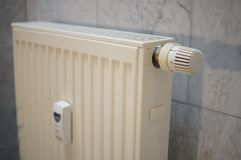 Heat regulator on a german heater in detail. Heat regulator on a german heater in white in detail Stock Images
