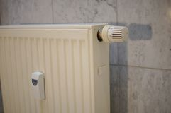Heat regulator on a german heater in detail. Heat regulator on a german heater in white in detail Royalty Free Stock Images