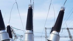 Heat-resistant insulators fasten wires at electrical substation. Closeup heat-resistant ceramic insulators fasten wires at electrical substation of constant and stock footage