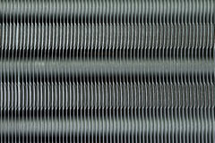 Heat sink of the air conditioner. Aluminum fins of heat exchange unit of air conditioner Royalty Free Stock Photography