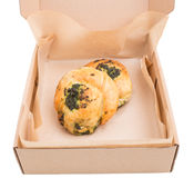 Heat spinach puff cakes in cardboard box. Royalty Free Stock Photography