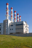 Heat station. Modern heat or power station and green meadow royalty free stock photography