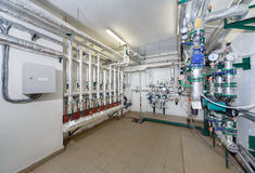 Heat substations interior with lots of pipes, gauges and measuri Royalty Free Stock Images