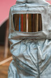 A heat suit with glass. A silver safety heat suit with a glass window Royalty Free Stock Image