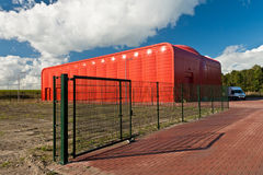Heat transfer station in Almere, The Netherlands. The complete red Heat transfer station with gate  in Almere, The Netherlands Royalty Free Stock Photography