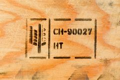 Heat treated wood. Pine tree and stamp Royalty Free Stock Photography