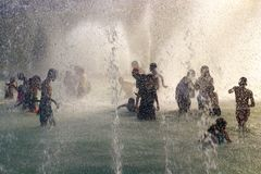 Heat wave cool off Summer in Paris Trocadero fountains by the Eiffel Tower. Enjoy the cold waters of fountain during a heat wave Heatwave alerts in the Paris  royalty free stock photo