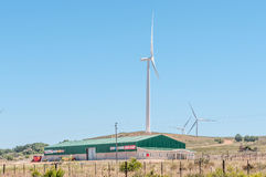 Heat waves distort wind driven turbines and building Stock Images