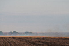 Heat waves from burning farmers field Royalty Free Stock Images