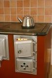 heated печка вверх грея древесину Стоковые Изображения
