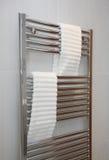 Heated Bathroom Towel Rail. Modern bathroom heated towel rail with chrome finish Stock Photos