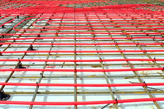 Heated floor installation. Plastic tube attached to a metal grid Stock Images