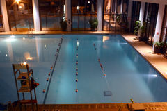 Heated Pool. An indoor heated swimming pool all lit up Royalty Free Stock Image