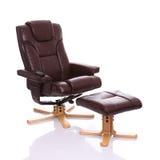 Heated reclinerstol för läder med footstoolen Arkivfoton