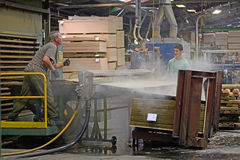 Heated sheets. GREYMOUTH, NEW ZEALAND, MAY 22, 2015 : workers stack freshly made  untrimmed sheets of plywood on May 22, 2015, near Greymouth, New Zealand Stock Photos