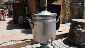 Heated and smoking samovar stands on the streets of Baku, Azerbaijan stock video