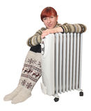 Heater. And the girl in warm golfs Stock Image