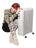 Heater. And the girl in warm golfs Royalty Free Stock Photography