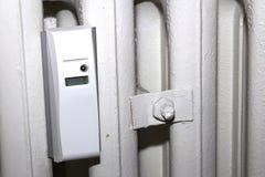 Heater meter. Plastic heater radio meter and metal pipe Royalty Free Stock Photos
