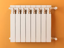 Heater radiator on yellow wall in house Royalty Free Stock Photography