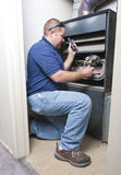 Heater Repair Man. Working on furnace in residential home