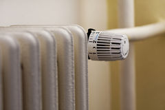 A heater with a thermostatic regulation valve. Stock Image