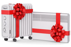 Heaters with red ribbon and bow Royalty Free Stock Photos