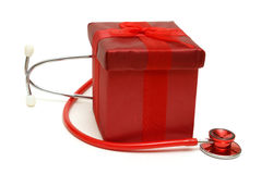 Heathcare Gift. A red gift box and stethoscope isolated on white Royalty Free Stock Image