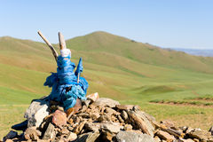Heathen praying mound. Heathen praying stone mound in Mongolian steppe stock photos