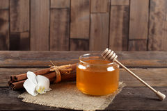 Heather honey and cinnamon on wooden table Stock Photo