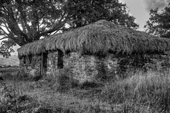 Heather thatched traditional scottish Black House now abandoned Royalty Free Stock Images