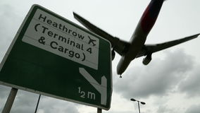 Heathrow Airport Sign with aircraft Flyover stock video