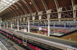 Heathrow Express Trains, Paddington Station. LONDON, UK  MAY 15, 2014:  Trains on London's Heathrow Express service waiting at platforms at Paddington Station Stock Photo