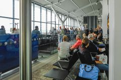 Heathrow Terminal 5, London, UK- September 25, 2017: People queu. Ing and waiting to board a British Airways flight. Typrical gate procedure Royalty Free Stock Photos
