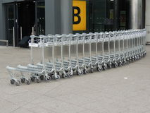 Heathrow trolley snake. Line of luggage trollies at Heathrow airport London Royalty Free Stock Photography