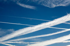 Heathrow Vapour Trails. A myriad of assorted aircraft vapour trails near Heathrow Airport Royalty Free Stock Photo