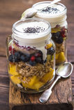 Heathy breakfast fruity salad and chia seeds. Heathy breakfast fruity salad with chia and basil seeds served in mason jar Stock Image
