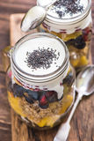 Heathy breakfast fruity salad and chia seeds. Heathy breakfast fruity salad with chia and basil seeds served in mason jar Royalty Free Stock Photo