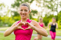 Heathy heart through regular workouts. Heathy heart through cardiovascular activity in fresh air Stock Photos