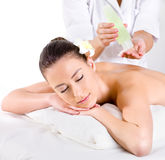 Heathy massage for young woman with aromatic oils. Horizontal - Beauty treatment Stock Image